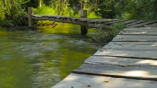 River, mountains, nature bridge crossing.(Time Lapse)