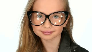 Teen girl posing in funny glasses, slow motion