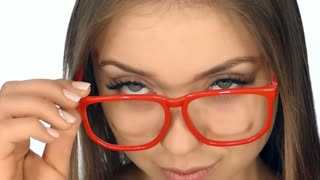 The girl in  glasses posing on a white background,slow motion