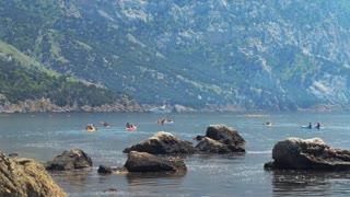 Traveler kayaking in the sea