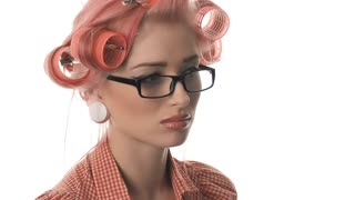 Very emotional girl in the style of pin-up in glasses