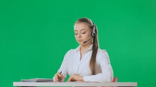 The call center employee answers the call, green screen, alpha