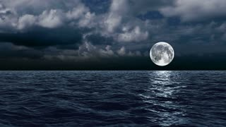 The moon over the sea in the clouds