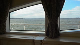 View through the window,illuminator of the yacht
