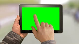 Walk with tablet PC, Green Screen on a green background.  Easy for tracking and keying