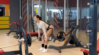 Woman bodybuilder trains the buttocks and back