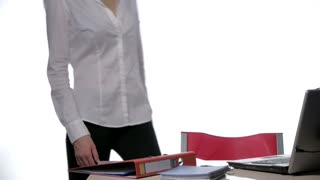 Young woman secretary at work in the office