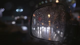2 in 1 video! The reflection of the rainy city in the left mirror of a car. Evening-night time, real time capture