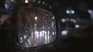 2 in 1 video! The reflection of the rainy city in the right mirror of a car. Evening-night time, real time capture
