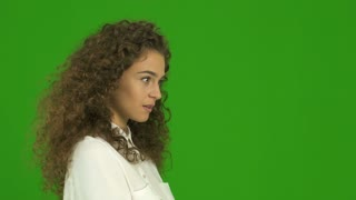 3 in 1 video! The beautiful curly woman portrait with wind on the green background. Real time capture