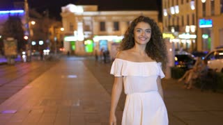 3 in 1 video! The beautiful woman walk on the evening street. Real time. Wide angle