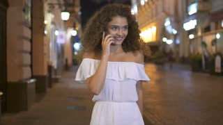 3 in 1 video! The cute woman walk and phone on the street. Evening night time. Slow motion. Wide angle