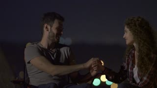 3 in 1 video! The lovely couple sit on the background of city light. Evening night time. Real time capture