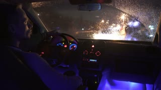 3 in 1 video! The man sit in a car in the rainy city. Inside view. Evening-night time