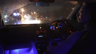 3 in 1 video! The man sit in a car in the rainy city with left hand traffic. Inside view