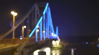 3 in 1 video! The picturesque backlight on the pedestrian bridge. Evening night time. Wide angle. Real time capture