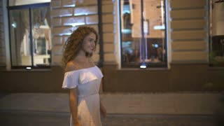 3 in 1 video! The young woman walk on the evening street. Real time. Wide angle