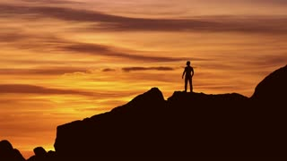 4 in 1 video! The man stand on the rock on the background of sunset. Real time