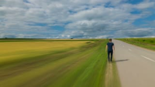 4 in 1 video! The man walk along the road against the background of cloud stream. Time lapse (Hyperlapse). Wide angle