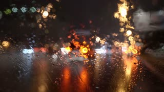 4 in 1 video! The view of the city through the blur windscreen. Evening-night time, real time capture