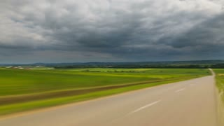 4 in 1 video! The walk along the road against the background of cloud stream. Time lapse (Hyperlapse). Wide angle