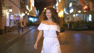 4 in 1 video! The young woman walk on the evening street. Slow motion. Wide angle