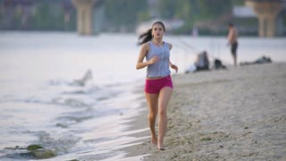 5 in 1! The woman run on the beach and listen music by river and bridge background