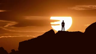 5 in 1 video! The man stand on the rock on the background of sunrise. Time lapse
