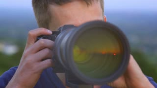 5 in 1 video! The man use the professional camera with telephoto lens. Real time capture