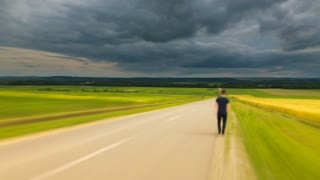 5 in 1 video! The man walk along the road against the background of cloud stream. Time lapse (Hyperlapse). Wide angle