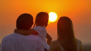 6 in 1 video! The family (father, mother and daughter) by sunset background. Real time capture. Shot with Red Cinema Camera
