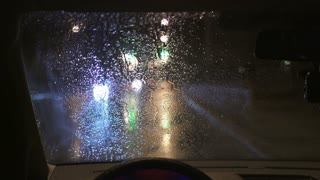 6 in 1 video! The raindrop fall on the windshield of the car. Inside view. Evening-night time, real time capture. Wide angle