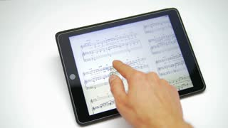 Hand work with music notes on the touchscreen by white background