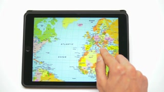 Hand work with world map on the touchscreen by white background