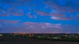 The beautiful thunderstorm on the background of the evening city. Time lapse. Wide angle