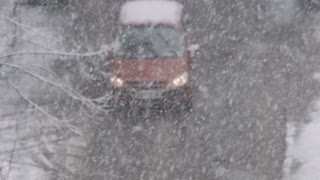 The car move in the snowy street during a heavy snowfall. Real time capture