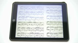 The hand (finger) work with music notes on the touchscreen by white background