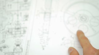 The hand (fingers) points on the blueprint engineering project