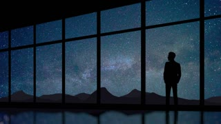 The man stand at the panoramic window on the background of starry sky. Time lapse. Wide angle