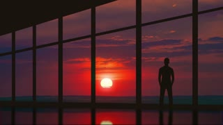The man stand at the panoramic window on the background of sunset. Time lapse. Wide angle