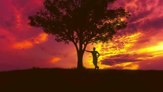 The man stand near the tree against the background of sunset. Time lapse
