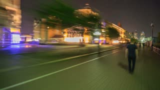 The man walk along the street in the night city. Time lapse (Hyperlapse). Wide angle
