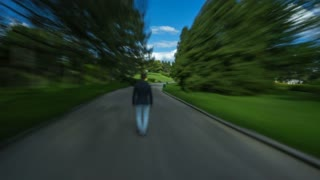 The man walk in the beautiful park. Time lapse (Hyperlapse). Wide angle