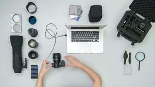 The man work with camera tool on the desktop. Time lapse (Hyperlapse). Wide angle