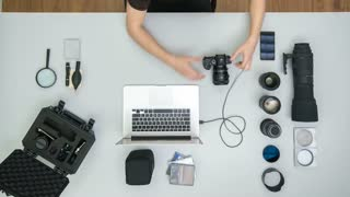 The man work with camera tool on the table. Time lapse (Hyperlapse). Wide angle
