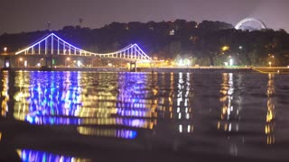 The picturesque embankment by night city and bridge lights background