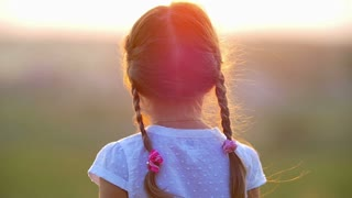 The small girl clap hands by landscape background. Slow motion capture