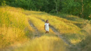 The small girl run on the way by forest background. Slow motion capture. Shot with Red Cinema Camera
