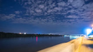 The walk along river in the night city. Time lapse (Hyperlapse). Wide angle