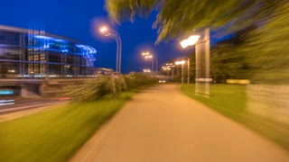 The walk in the park on a background of the night city. Time lapse (Hyperlapse). Wide angle